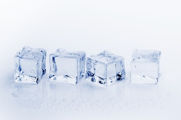 Image of 4 ice cubes in a row which are starting to melt